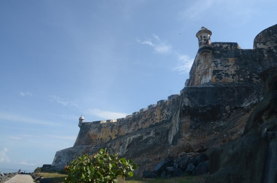 Looking up at the massive walls of El Morro.