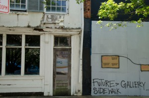 Unrestored storefront on Dexter St.