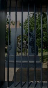 This sculpture shows children behind jail bars - the children who participated in the demonstration were jailed, and house right beside prostitutes, murderers and thieves.
