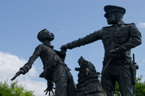 This sculpture recreates a news photograph of the same scene - where the policeman allows the dog to attack a man.