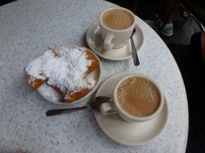 Cafe au lait and beignets at Cafe du Monde