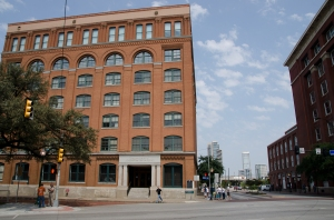 The Texas School Book Depository.  Count up six stories, in the corner, and that' where the shooter was...