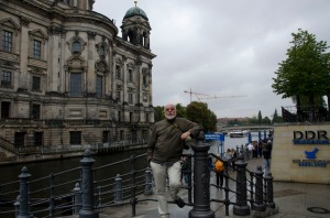 Gerry poses in front of the DDR Museum with the cathedral in the background.