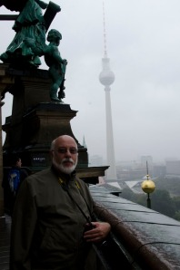 Gerry, the typical grey rainy sky of Berlin, and the TV tower in the mist.
