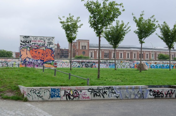 This is the Berlin Wall, the East-Side Gallery.  We are looking at two layers of it (there were three).  The tall section in the foreground is one layer and the long section behind is another,