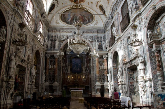 An island of tranquility in the bustling market - the Sicilian Baroque church of the Immaculata.