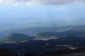 Looking back down the volcano - from the cable car.  You can see the white bus we rode as it traverses a gravelly path.