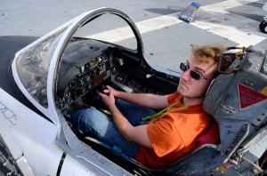 Oscar tries his hand at the controls of a fighter plane ...