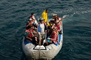 A panga full of passengers.  Guide Hernan is in the bow.