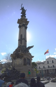 The column of historic symbols in the main plaza of Quito's historic center.