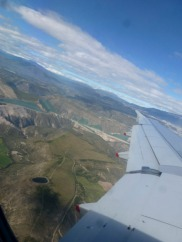 Shot from the plane and hopefully showing you the dramatic contours of the landscape below us - high mountains and deep valleys.