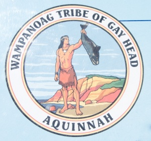 The emblem of the Wampanoag Tribe of gay Head, Aquinnah featuring the god, Moshup with a whale.