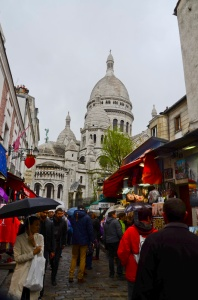 Montmartre street with Sacre Couer in the background.