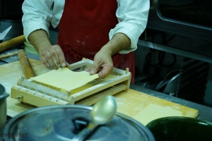 "The sheet of fresh pasta, rolled very thin is placed on top of a contraption with minutely spaced wires, called a ""chitarra"" (a guitar)."