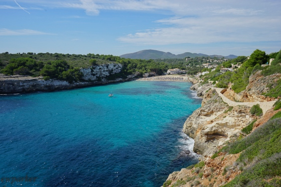 From the walkway on the cliffs of Cala d'Estany, looking backwards to the beach. Look at that water!!!