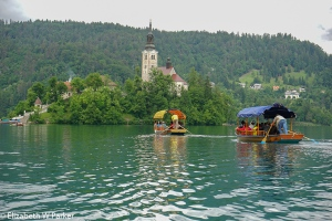 Chapel of St. Mary in Lake Bled. Pletna boats approach.