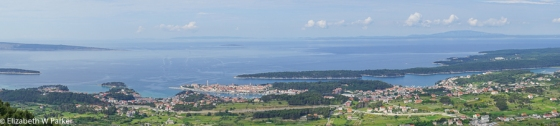 "Bigger panorama looking west"" Rab Tow has its four towers and the dark shapes on the horizon are more islands."